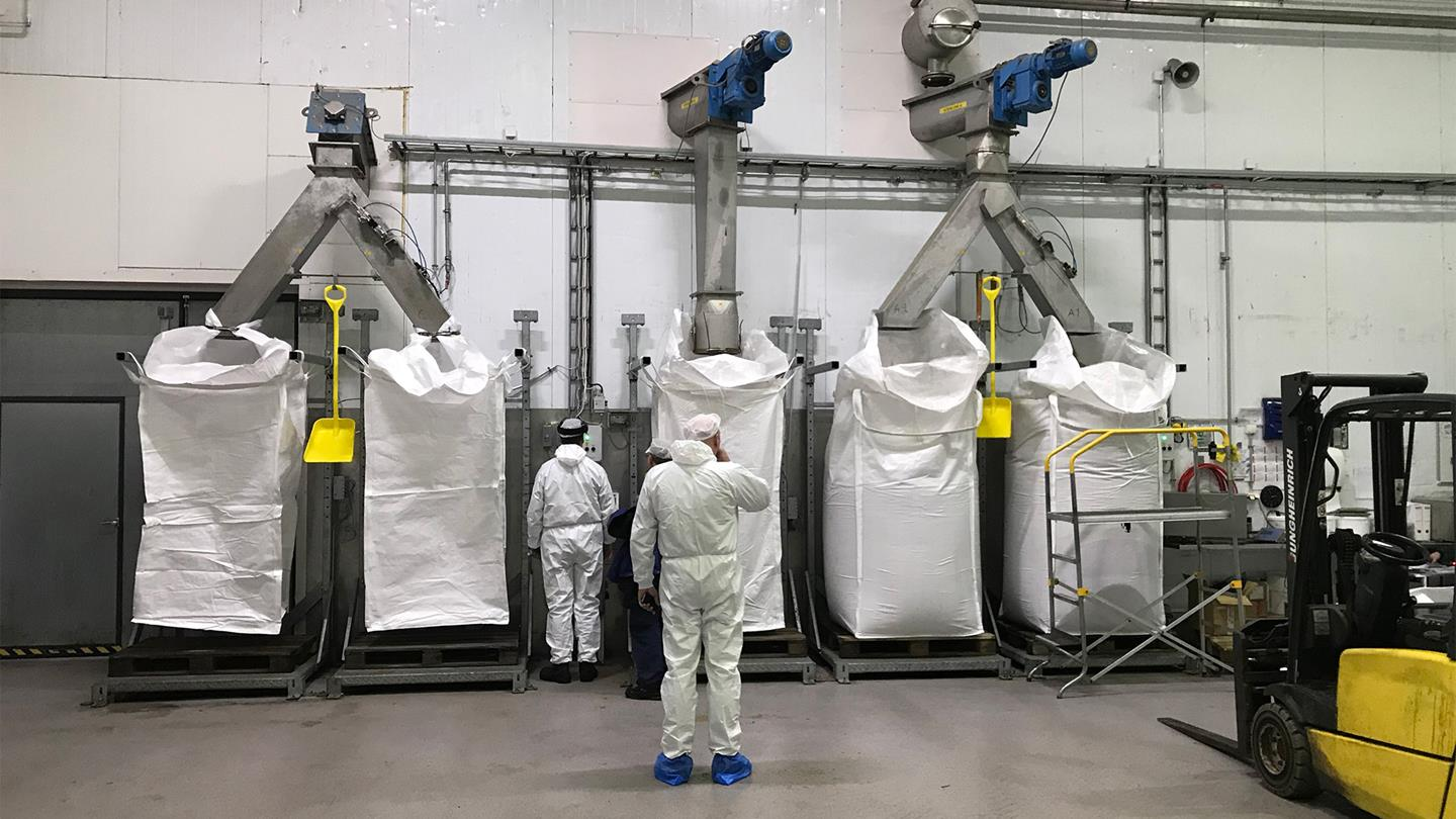 The BioMar audit team gains first hand impressions on how freshly processed fish meal is being bagged.